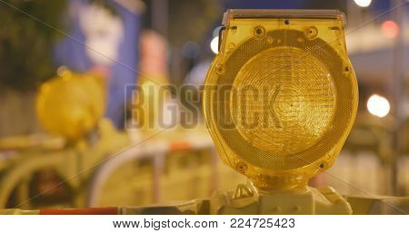 Warning light in yellow in construction site at night