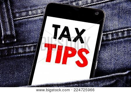Writing text showing Tax Tips. Business concept for Taxpayer Assistance Refund Reimbursement written mobile cell phone with space in the back pants trousers pocket