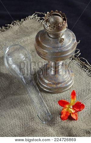 An ancient kerosene lamp on the table. Vintage, retro, object