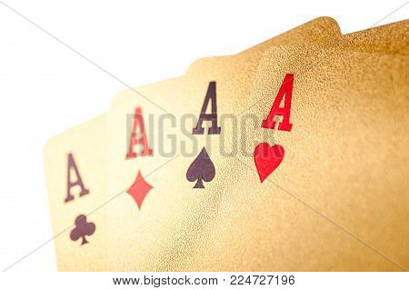Golden playing poker cards on white background