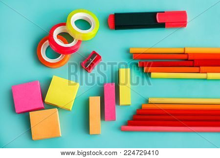 portrait of colorful office stationary on pastel background