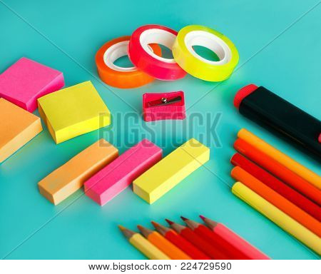 close up portrait of colorful office stationary on pastel background