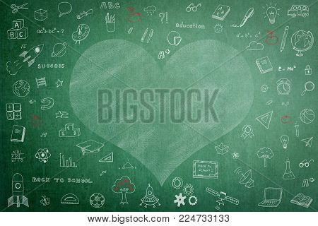 Doodle freehand white chalk drawing on green chalkboard with heart copy space for Educational back to school and teacher's day concept