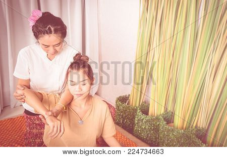 Woman is getting arm massage in Thai massage spa