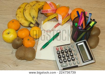 Concept of diet. Low-calorie vegetables diet. Diet for weight loss. Fruits and vitamins with measuring tape