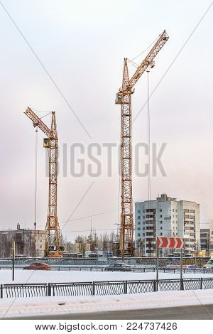 the image two cranes at construction site