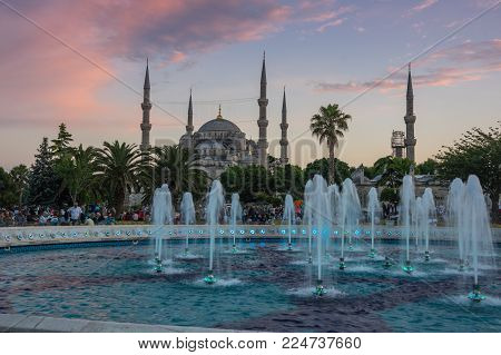 ISTANBUL, TURKEY - JUNE 25, 2015: Sultan Ahmet Mosque (Turkish: Sultan Ahmet Camii), is a historic mosque in Istanbul, Turkey. The mosque is popularly known as the Blue Mosque for the blue tiles adorning the walls of its interior