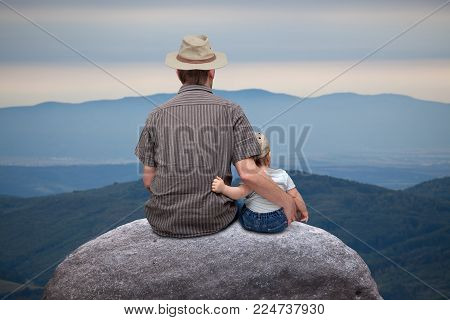 father with little son in the mountains