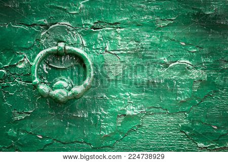 Green wood old knock door. Vintage style. Ideal for backgrounds and texture. Space for text.