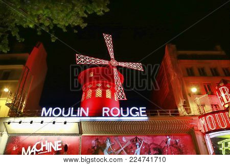 PARIS / FRANCE - 30 APRIL 2017: View of the Moulin Rouge (Red Mill) at night in Paris, a landmark cabaret in the Montmartre neighborhood of the French capital.