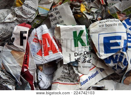 Kiev, Ukraine - February 02, 2018: ILLUSTRATIVE EDITORIAL Crumpled newspapers that publish false news in different foreign languages are thrown out in the trash as an illustration of fake news unacceptability