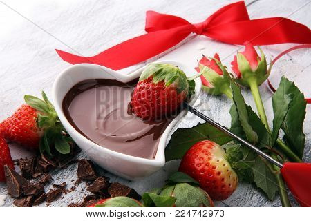 Valentine Chocolate fondue melted with fresh strawberries and dark chocolate and roses