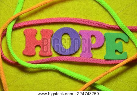 word hope on an  abstract colrd background
