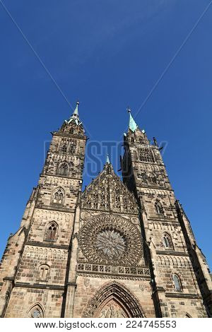 Saint Lawrence cathedral (St. Lorenz) over clear blue sky, medieval gothic church in Nuremberg, Germany, low angle front view