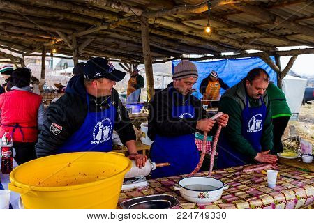 Hecha, Ukraine - January 27, 2018: A team of hungarian butchers produces sausages during the 12th International Butchers Festival.