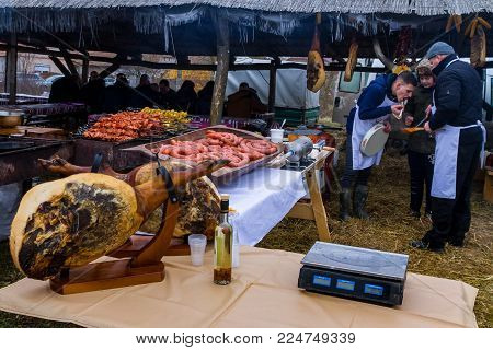 Hecha, Ukraine - January 27, 2018: A team of butchers tasting fresh pork dishes during the 12th International Butchers Festival.