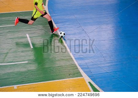 Football player on field Small, Futsal ball field in the gym indoor, Soccer sport field