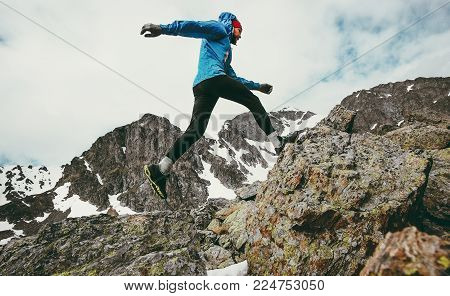 Travel Man running in mountains adventure lifestyle endurance concept active vacations skyrunning sport