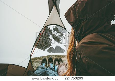 Travel couple in tent camping relaxing inside Lifestyle concept adventure vacations outdoor