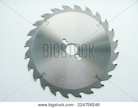 Steel round saw with sharp teeth insulated on light background