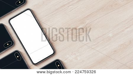 iPhone X style smartphone mockup banner with copy space. Smartphones mockup top view flat lay. Smartphone mockup lying on wooden office desk. 3D illustration.
