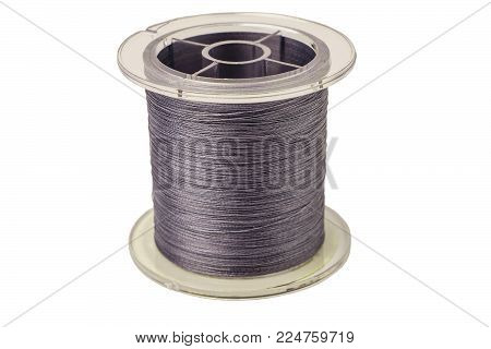 Spool of gray cord on white background. Spool of braided fishing line.