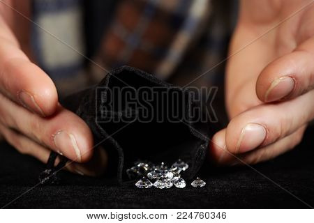 Old style diamond smuggler preparing goods for dealing