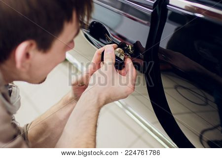a man hands repair left door Car locks repair man Black