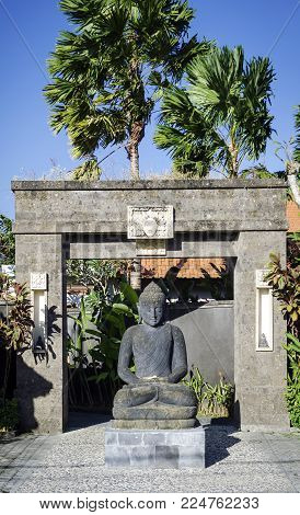 traditional balinese stone buddha statue and doorway in bali indonesia