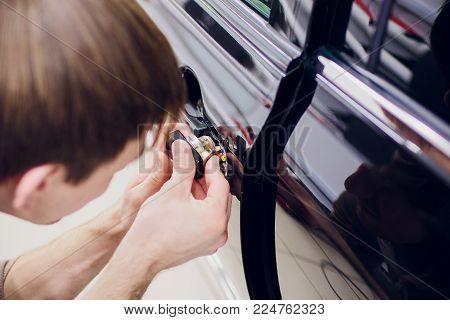 a man hands repair left door Car locks repair man Black