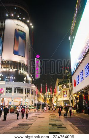 GUANGZHOU, CHINA - JANUARY 2, 2018: Beijing Road Pedestrian Street in old part of Guangzhou with many stores and restaurants at night