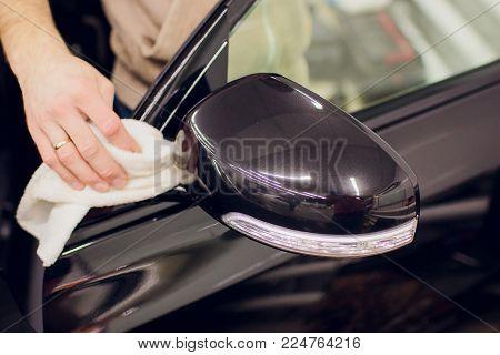 Car mirror man repair, Car accident broken side mirror. Black