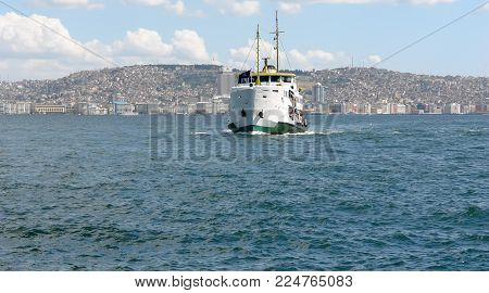 White ferry, panorama of the harbor and the city of Izmir. Aegean Sea, Turkey.