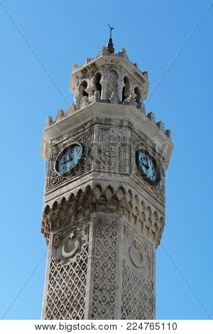 Fragment of historical the Clock Tower with a large clock in the central Konak Square in Izmir, Turkey.
