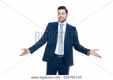 smiling businessman with shrug gesture, isolated on white