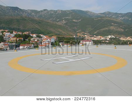 A helipad located high in mountains, Montenegro. A helipad surrounded by mountain tops in a very picturesque place.