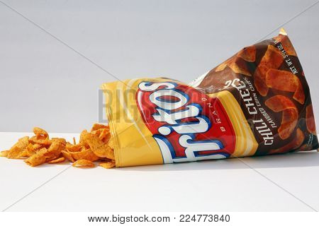 Lake Forest, CA, January 31, 2018: Bag of Chili Cheese flavor Fritos corn chips which is owned by Frito-Lay.