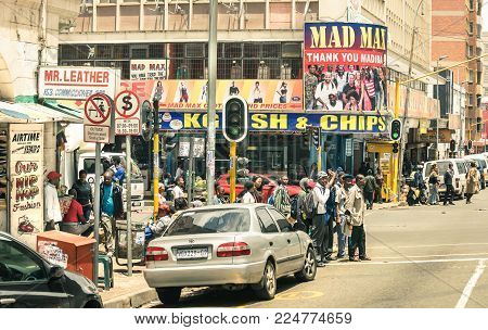JOHANNESBURG, SOUTH AFRICA - NOVEMBER 13, 2014: rush hour and traffic jam near Von Wiellig Street at crossroad with Commissioner St in the crowded and modern multiracial metropolis of South Africa