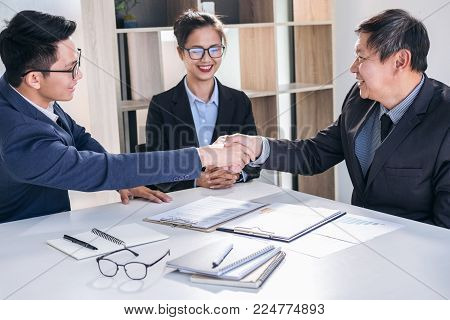 Finishing up a meeting, Business handshake after discussing good deal of Trading contract for both companies and gesturing people connection deal, Meeting and greeting concept.