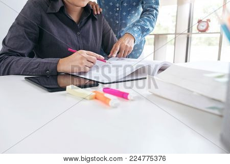 Images Of Disappointed, Young Students Campus Or Classmates Helps Friend Catching Up Workbook And Le