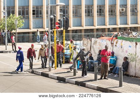 JOHANNESBURG, SOUTH AFRICA - NOVEMBER 13, 2014: everyday life near Gandhi square. After the renovation finished in 2002 the area got a renovated bus terminal , 24-hour security, and many new shops