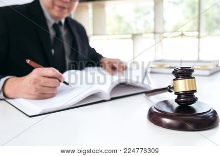 Close Up Of Gavel, Male Lawyer Or Judge Working With Law Book, Report The Case On Table In Modern Of
