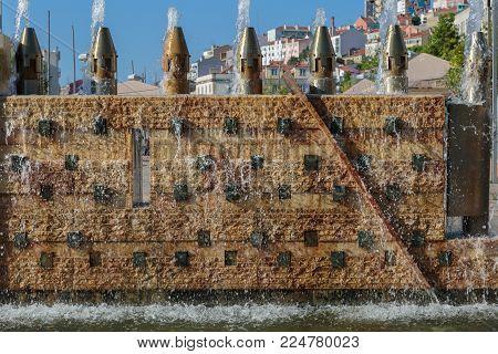 Fountain's Wall with Flowing Water in Portugal.