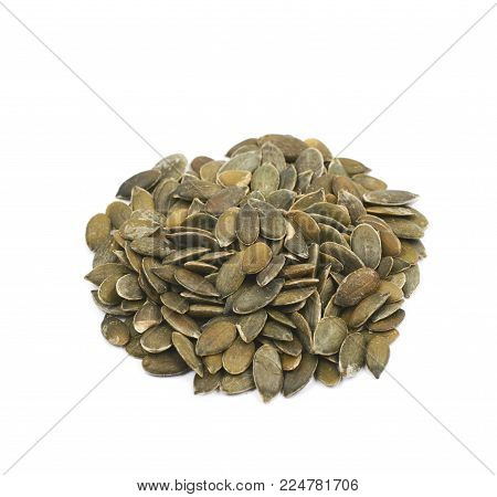 Measured portion of exactly one hundred calories of pumpkin seeds isolated over the white background