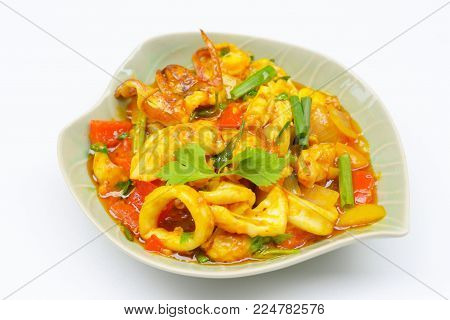 Stir fried fresh squid with yoke eggs ,onion and chili.