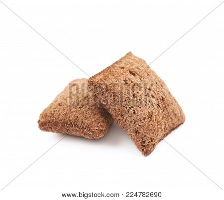Measured portion of exactly one hundred calories of the chocolate pillow cereals isolated over the white background