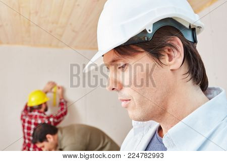 Craftsman thinking about problem and looking for expert solution