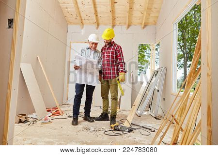 Master craftsman and artisan working and planning new building