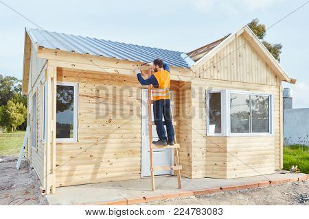 Building construction of new woodhouse as summer vacation house