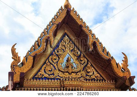 Temple of the Emerald Buddha details close-up, a small golden Buddha, ornaments and roof decoration